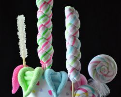 Gift wrap a washcloth or onesie to look like a lollipop. Cute for a baby shower gift.