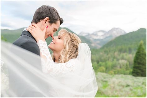 Candid photos of bride in lace dress and groom in black suit with deep pink and white floral bouquet | Utah Mountain Wedding Formal Session | Tibble Fork Summer Formal Session | Jessie and Dallin Photography #utahwedding #utahsummerwedding #utahbride #utahweddings #utahvalleybride #summerwedding #mountainwedding #utahelopement #utahmountains #rockymountainwedding #tibblefork #elopement