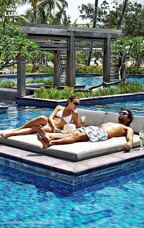 Couple enjoy sunbathing in a luxury spa pool at Long Beach Resort Mauritius #travel #spa #mauritius #romantic