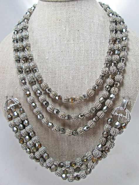 This classic Trifari set is from the early 1960s Electra Collection and was featured in ads. The triple-strand set features a combination of