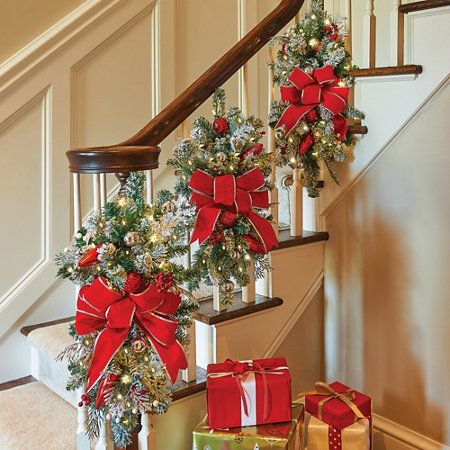 christmas stairs - I like wrapping with greens instead of draping and the  bows look really pretty | Christmas | Pinterest | Christmas stairs, ...