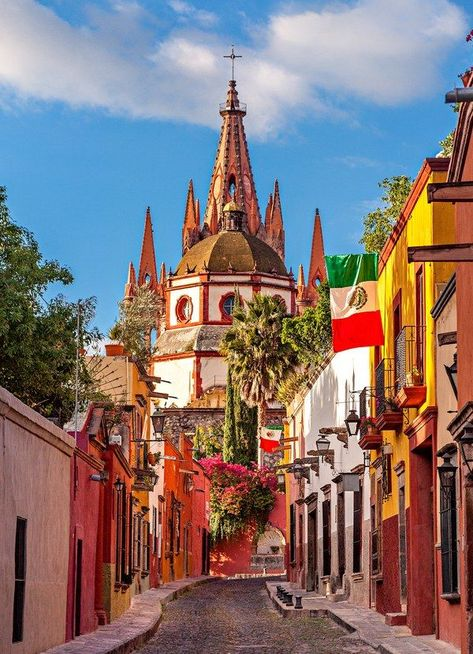 "Aldama Street in San Miguel De Allende is a must-see for any traveler heading to centrally located Mexican city. Roughly 170 miles north of Mexico City, San Miguel De Allende was voted the Best City in the World"" by Travel + Leisure. Lonely Planet, Places To Travel, Places To Go, Visit Mexico, Beautiful Streets, Beautiful Places, Thinking Day, Puerto Vallarta, Travel And Leisure"