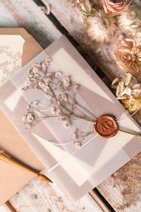 rustic wedding invitation with wax seal baby breath flowers