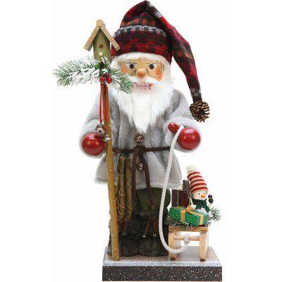 The Holiday Aisle Christian Ulbricht Santa with Sled Nutcracker Holiday Shaped Ornament