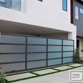 Modern Sliding Driveway Gate In A Bronze Metal Frame With Frosted Glass Panes Yelp Garage Doors House Gate Design Entrance Gates Design