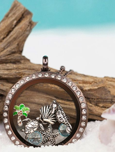 Just Beachy! Origami Owl Lockets tell a story - What is your story? To place your order, visit my website at http://yourcharminglocket.origamiowl.com/ Have further questions, message me on Facebook https://www.facebook.com/YourCharmingLocket. --LIKE OUR FAN PAGE FOR A CHANCE TO WIN A FREE CHARM. 3 WINNERS EVERY MONTH--- Want more than just one locket, consider joining our team for an extra income.