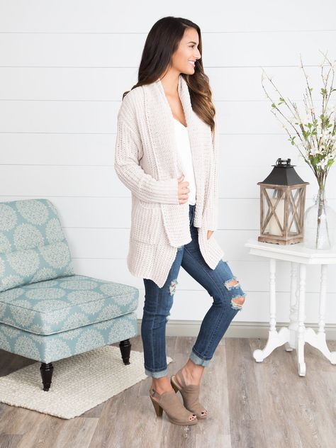 Elevate your cozy-chic style game with this chunky knit cardigan featuring a shawl collar, longer length and front pockets. Ultra-soft and oh-so cozy this style is perfect for chilly days and hot cocoa! We've paired it with the back to basics pocket top, olivia distressed skinny jeans and wake up peep-toe booties for a cozy-cute look. 100% Polyester. Runs true to size with a slouchy fit. If you are in between sizes, consider sizing down. Lacy is size 0, 5'