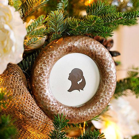 Transform silver frames and silhouettes into one-of-a-kind, antique-inspired Christmas ornaments! For more beautiful handmade Christmas ornament ideas, look here: http://www.bhg.com/christmas/ornaments/easy-christmas-ornaments/?socsrc=bhgpin122414heirloomstyleornaments&page=19