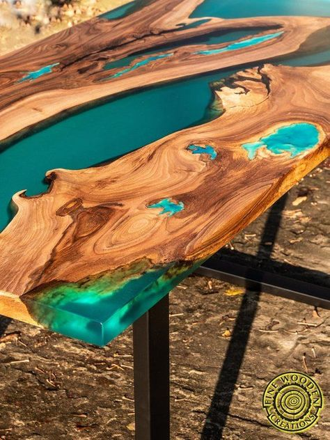 Turquoise resin dining table made of walnut wood. Live edge river made of semitransparent blue/turquoise resin. Some cracks are filled with resin glowing in the dark.  TABLE IS SOLD AND CAN BE BUILD PER CUSTOM ORDER/MADE TO ORDER.  Glowing turquoise resin shines in the dark for