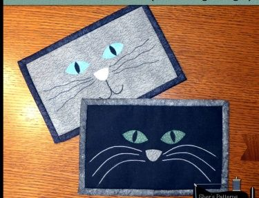 PDF Pattern to make this cat themed mug rug or cat mini quilt. Made with a combination of appliqu