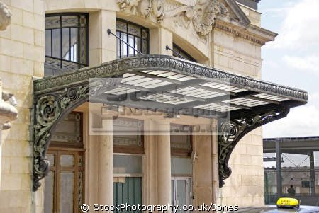 Art Nouveau Awning Made Of Glass And Wrought Iron Over A Beautiful Carved Wood Door With Window Boxes Flowers Paris France