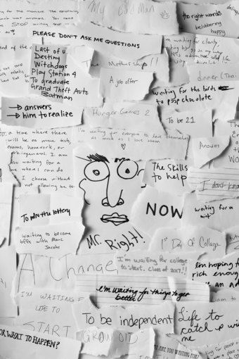 """The Whitney Museum recently sponsored a public art project with artist Gary Simmons. To make the project, teens collected responses to the question, """"What are you waiting for?"""" from their classmates and the larger community. The handwritten scraps of paper were then photographed, printed, and wheatpasted onto a wall, creating a layered, complex, and sometimes contradictory collection of voices and opinions"""