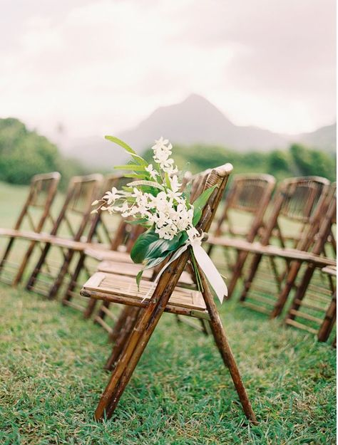 PRO TIP: Keep the smallest details in mind. Sometimes all it takes to elevate a space is the smallest touch. We added these miniature bouquets to these bamboo chairs for some added romance. Design by  Moana Events  #weddingceremony #babybouquets #bambooch