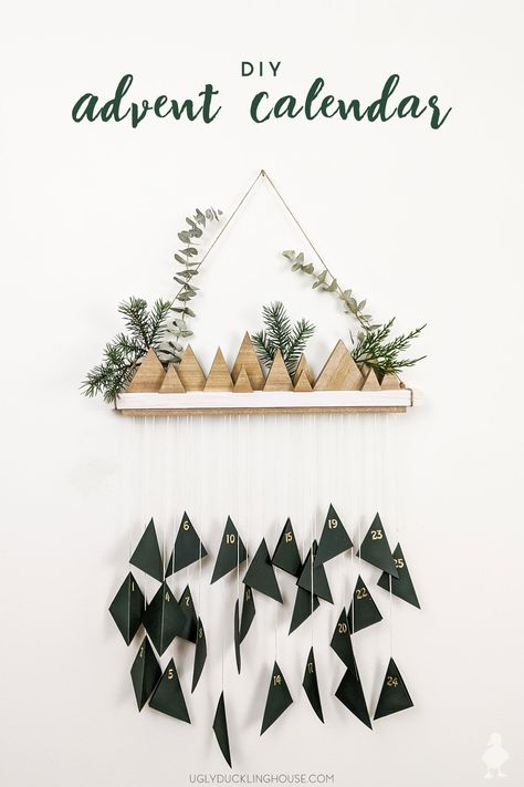 This boho-inspired hanging advent calendar can be whipped up in less than a day! Countdown to Christmas with this easy project you can make from scrap wood and materials found around the home. #adventcalendar #diy #boho #mountains #christmastree #christmascountdown #scrapwood #woodstain #hangingcalendar