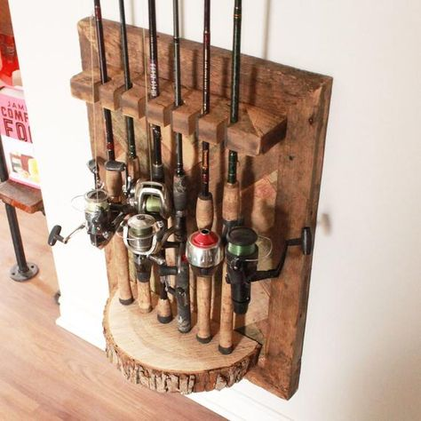 Display your fishing rods in style, so theyre always at the ready for the next big catch. This barn wood herringbone and maple fishing rod rack will hold six of your prized fishing rods. The maple half-round is the perfect, rustic base, with a stunning he Fishing Pole Storage, Fishing Pole Holder, Pole Holders, Fishing Rods, Fishing Lures, Fly Fishing, Women Fishing, Crappie Fishing, Saltwater Fishing