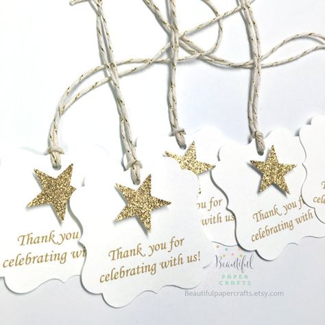 Twinkle Twinkle Little Star Tags - Q U A N T I T Y - • 12 tags adorned with gold glitter star - S I Z E - • Each tag is 2 x 2 and are pre-strung with 12 coordinating bakers twine or ribbon, back is blank. **Ribbon may vary, but will always coordinate, due to availability. - C