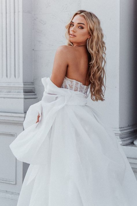 An all-white bridal ball gown you will love - our Galia Lahav #Meghan with its voluminous coat with balloon sleeves that fasten at the neckline with an oversized statement bow.