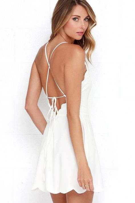 The little white dress is every stylish girl's must-have, and the Play On Curves Ivory Backless Dress is one you'll cherish forever! Skinny straps support a high rounded neckline as they crisscross and tie over an alluring open back with scalloped trim. The lightweight, woven bodice has princess seams that travel to a fitted waist, above the flaring skirt (with more scalloped detail!). Hidden back zipper with clasp. As Seen On Jenna of Visions of Vogue blog!