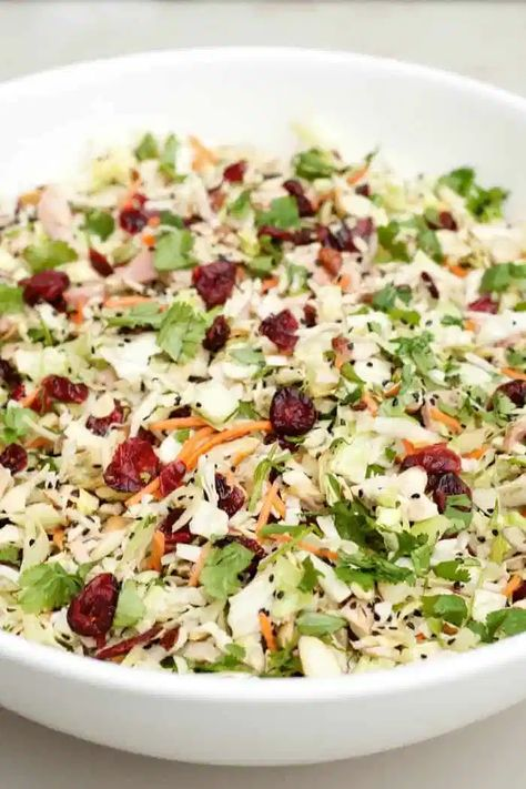 BEST Asian Chicken Cranberry Salad, a main dish or side dish that is popular at any potluck or holiday party! #chickenrecipes #chickenbreastrecipes #chickensalad #asianchickensalad #holidayrecipe #potllucksalad #potluckrecipes #asiansalad #reluctantentertainer #easymeals