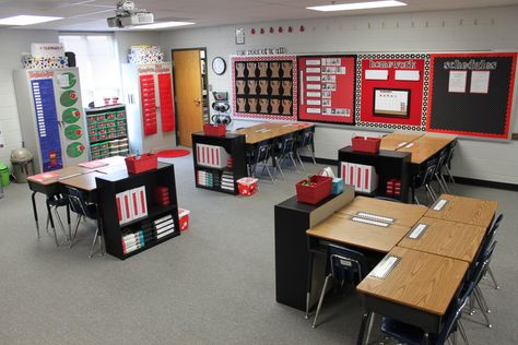 I love this classroom!! Such a great way to organize a classroom. Each group has their own trash can and book shelf!