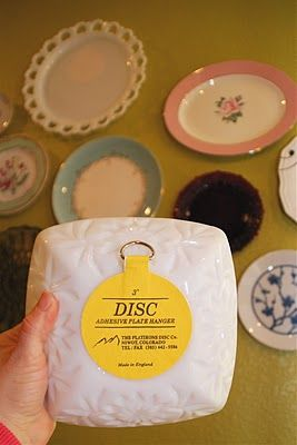 """The plates are hung using adhesive discs. The 4"""" disc can support a plate up to 6lbs. They have little metal hooks so they're easy to hang, and the discs come right off with hot water! From Hobby Lobby: The small ones were 1.99, the large ones were 2.99."""