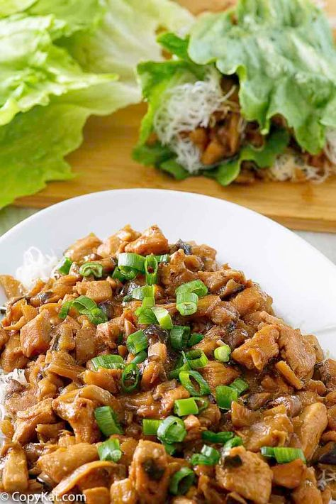 Chicken Lettuce Wraps are delicious, healthy, and full of Asian flavors. Get the easy P.F. Chang's copycat recipe and find out how to make the best chicken lettuce wraps. Great for a quick stir-fry dinner! #chickendinner #stirfry #asianfood #quickandeasy #lettucewraps #copycat #copycatrecipe