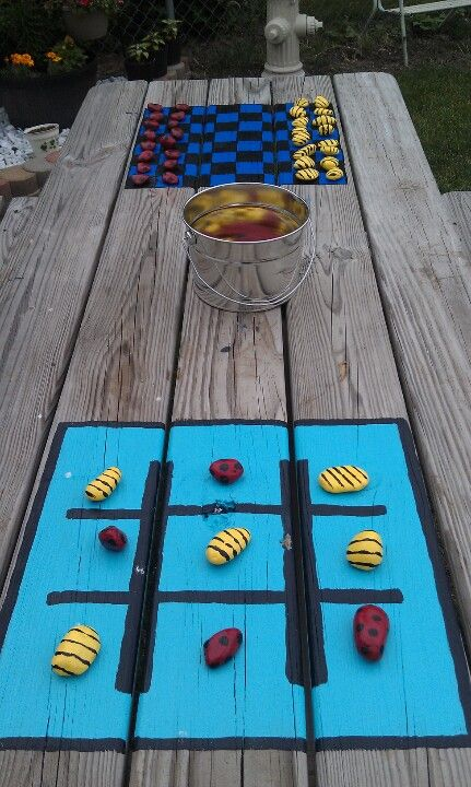 We have a small yard, so utilizing space and making the most of what we have is the goal. Painted checker board and tic tac toe on picnic table.  Painted rocks like lady bugs and bumblebees for pieces.  Now 2 more games for kids to play outside.
