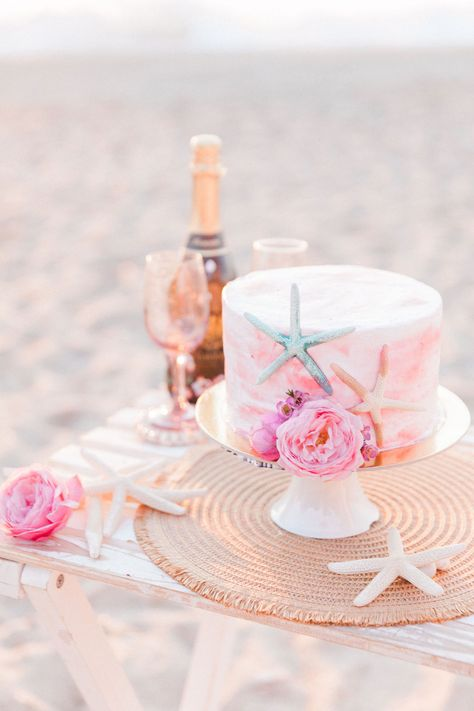 This pretty micro beach wedding in Lefkada was full of sweet treats for the family. This single tier, blush pink, beach theme wedding cake decorated with peonies and starfish was a surprise gift from the bride's sister! Planner Lefkas Weddings with Maxeen Kim Photography #beachweddinggreece #destinationbeachwedding #destinationweddingcake
