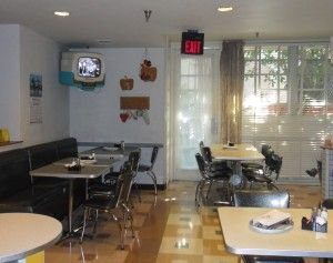 """Love the """"TV Tables"""" that show clips of mid-50s sitcoms like """"Father Knows Best"""" This is at 50's Prime Time Cafe in Disney's Hollywood Studios."""
