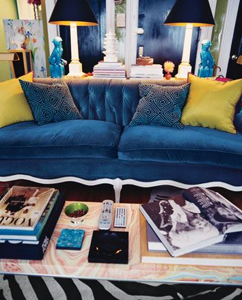 Love the black frames. Blue velvet couch, pink pillow and green ...