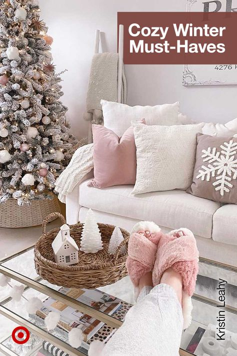 Set the Christmas mood with a frosted tree for a winter aesthetic  living room decor in blush pink  neutral tones.