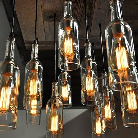 This pendant is handmade from reclaimed wood. The pendant wiring is a black cord with satin sockets and 11 professionally cut and polished cascading recycled wine bottles. It is breathtaking in person. This would be the focal point in any room. Empty Wine Bottles, Recycled Wine Bottles, Wine Bottle Art, Alcohol Bottles, Lighted Wine Bottles, Diy Bottle, Bottle Lights, Wine Bottle Torches, Cutting Wine Bottles
