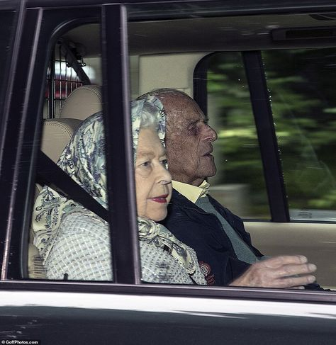 Her Majesty sported a blue and purple silk headscarf with a deep red lipstick while Prince...