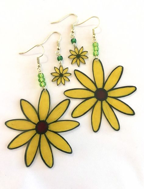 Excited to share these earrings from my shop, Off the Cuff Crafts: Yellow Daisy Shrink Plastic Earrings, Daisy Shrinky Dink Earrings in two sizes Shrink Plastic Jewelry, Plastic Earrings, Paper Earrings, Diy Earrings, Shrink Art, Custom Earrings, Shrinky Dinks, Bakery Design, Cafe Design