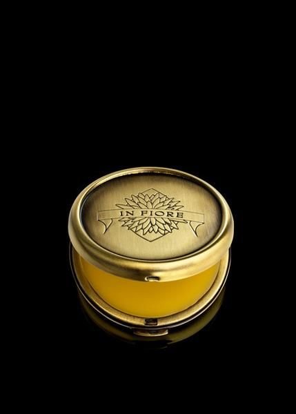 In Fiore - Fumé d'ambre solid perfume - The mystery unfolds into a smoky invitation of Incense, Madagascan Vetiver, and Dark Patchouli Leaves then gently leads into the rich musk of sweet amber. Packaged in a beautiful compact.