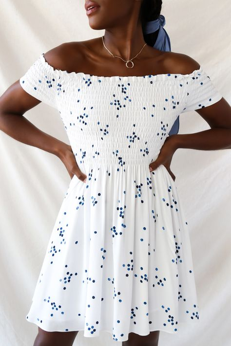 Looking for the perfect sundress? Lulus Santa Monica pier blue and white print off-the-shoulder dress has you covered, no matter what your summer plans are. Smocking, off the shoulder sleeves, and a polka dot print add the perfect amount of detail to this short white mini dress. #lovelulus