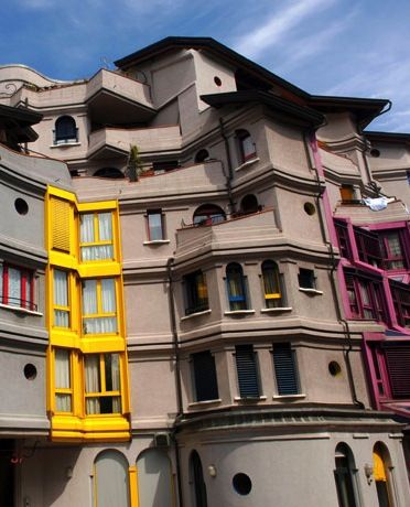 While exploring Geneva's Quartier des Grottes neighbourhood, look at the buildings at 23 to 29 Rue Louis Favre. Constructed between 1982 and 1984 by three unconventional architects, the Gaudi-style cartoon-esque structures are hard to overlook.