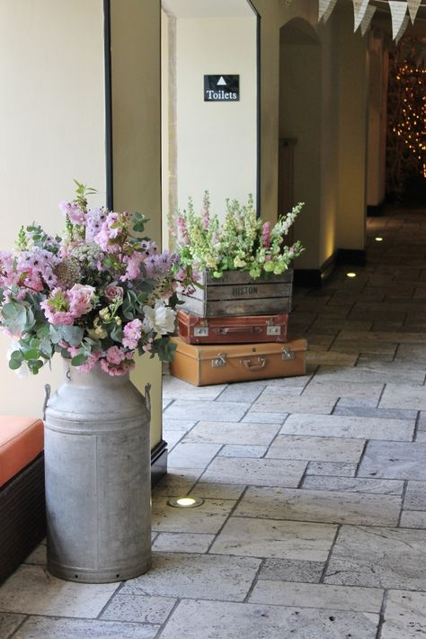 Milk churns and crates with flowers - maybe an idea for some decoration around the marquee/hall