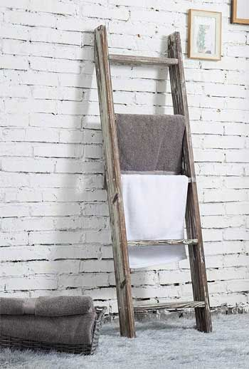 What Are The Advantages And Disadvantages Of Using A Leaning Ladder Towel Rack In Your Bathroom And Is It Better Ladder Towel Racks Towel Rack Leaning Ladder