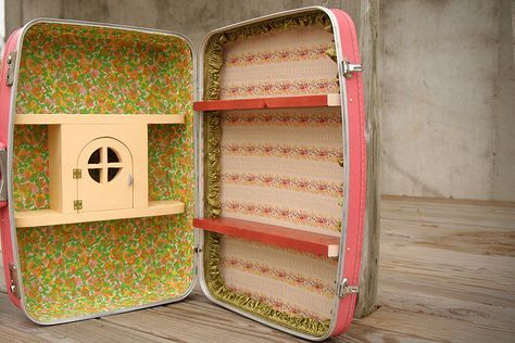 modifying a vintage suitcase for craft show displays. Would be cute for jewelry!