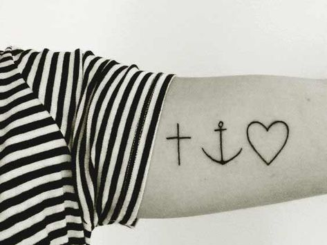 Small cross anchor and heart tattoo designs on arm.