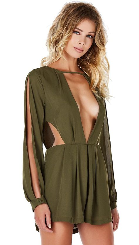 A sultry chiffon romper with daring cut outs all around and deep plunge. Mirrored cut in both front and back with flowy lined bottoms. Long sleeves with open slits with single button and zipper in…