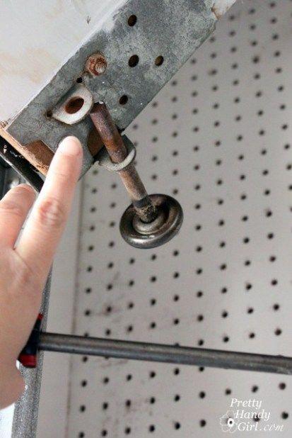 How To Replace Garage Door Rollers Garage Door Rollers Garage Doors Garage Door Maintenance