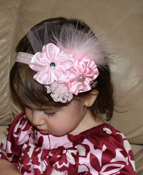 Pink Triple Boutique Flower Roses with Rhinestone Pearl and Feather Accents on Elastic Headband Photo Prop - Many sizes available. $15.99, via Etsy.