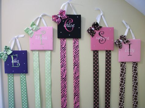 Bow holders embroidered custom made by SelectStyleBoutique on Etsy, $19.99. Or DIY with a wood block and some ribbon!