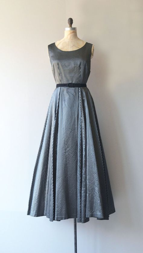Vintage 1950s black and metallic silver faille gown sleeveless bodice, fitted waist, black belt, metal zipper and decadently wide sweep skirt. --- M E