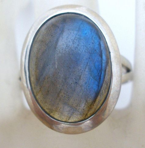 Gemstone Jewellery - This is a sterling silver ring with a large oval labradorite gem. It is a size face measures slightly over long by wide, hallmarked signed TGGC, weighs grams. The stone has beautiful reflections of blue,