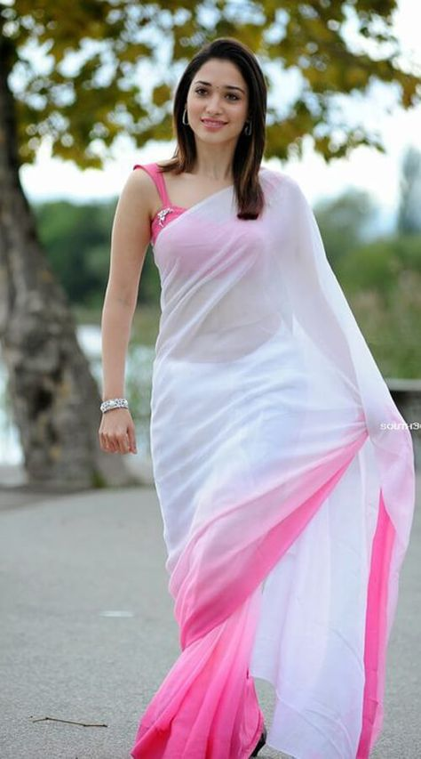 Tamanna Bhatia images in a White saree are clicked from 'Oosaravelli' movie. Tamanna looks like an angel in the white & pink colour saree. Beautiful Girl Indian, Most Beautiful Indian Actress, Beautiful Saree, Beautiful Women, White Saree, Pink Saree, Saree Models, Stylish Sarees, Short Dresses