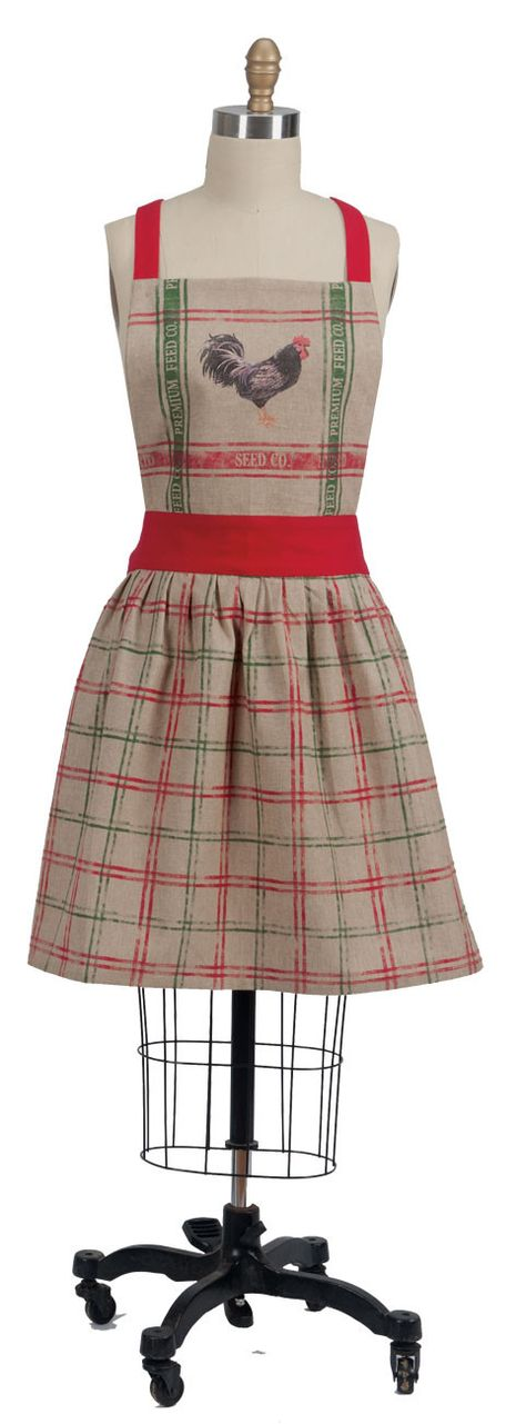 Cook and bake while feeling fabulous in the pretty and cute chambray Home To Roost kitchen women's Apron. Featuring a fun red and green plaid design complete with centered rooster imprint over tan on