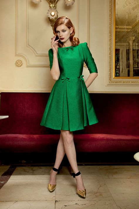 This lovely, tailored retro style dress in emerald green works for the petite woman.